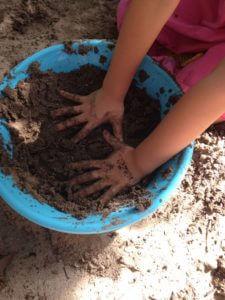 Children playing in mud kitchen
